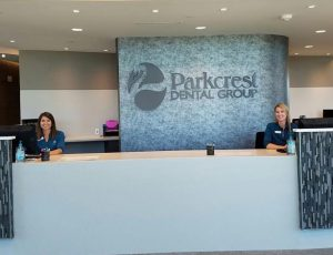 Parkcrest Dental Group front desk with staff.