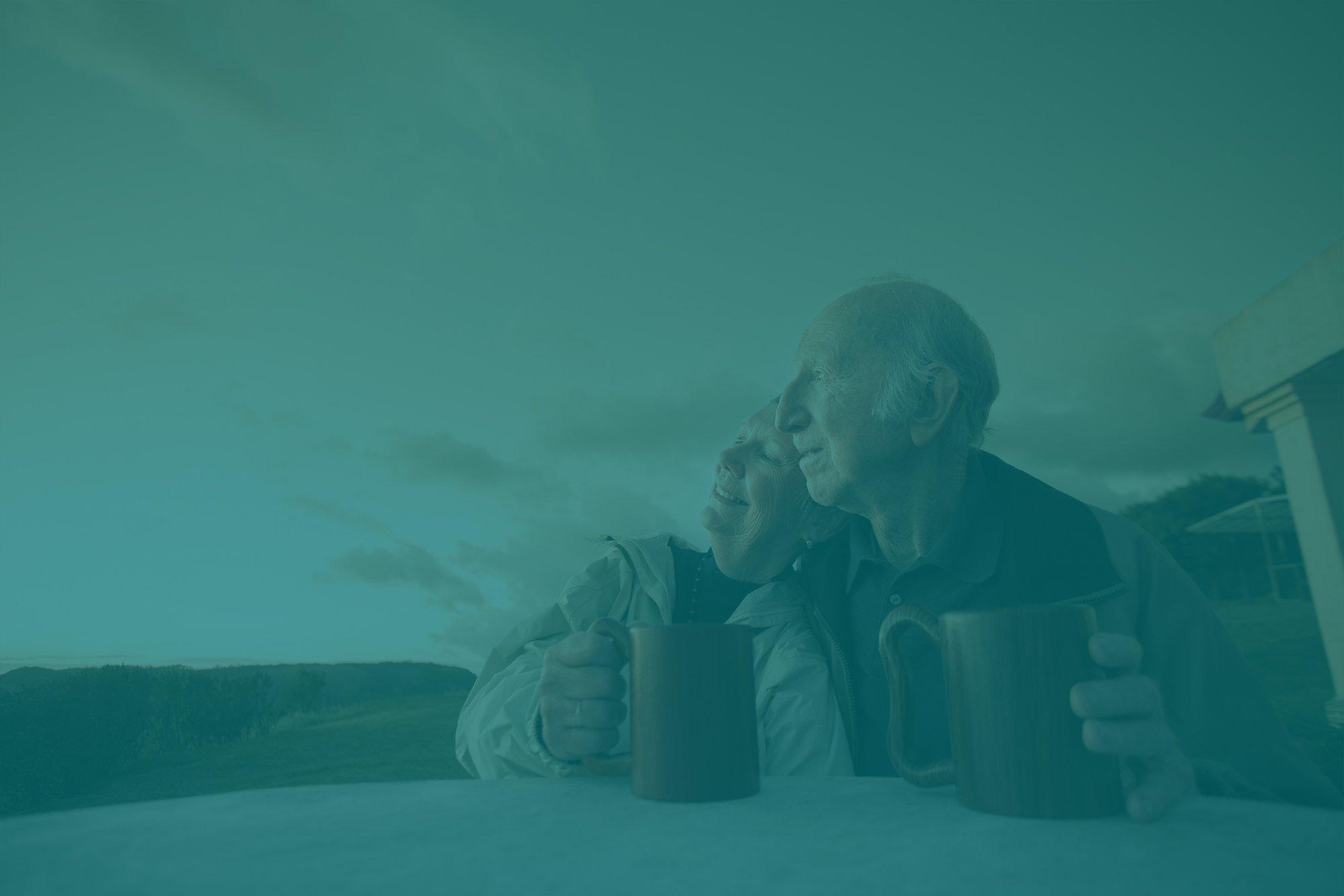 Older couple sitting outside together - Parkcrest Dental Care.