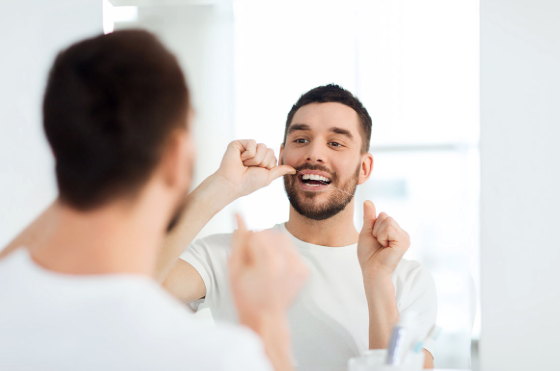 parkcrest dental group encourages-flossing-in-this-way