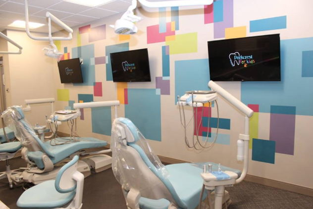 Pediatric dentistry clinic with TV monitors.