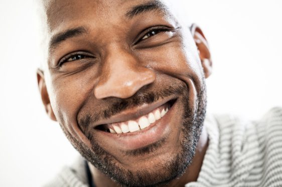 Man smiling close-up high res - cosmetic dentistry.