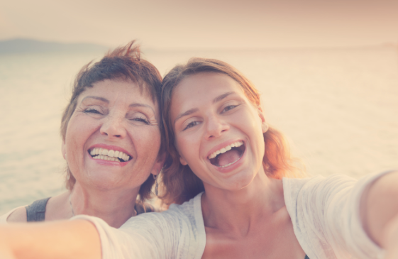 Mother and daughter beach selfie - Parkcrest Dental Group.