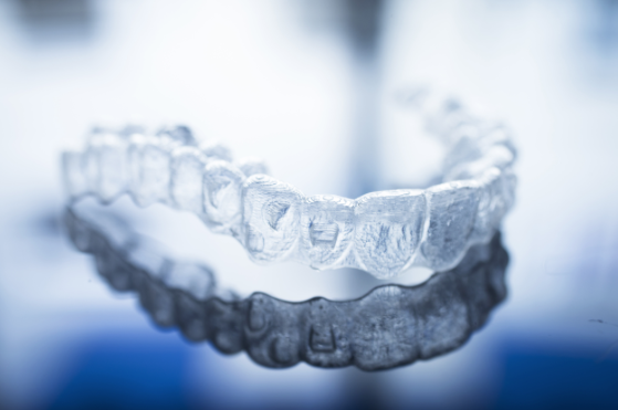 Invisalign braces close up - orthodontic dentistry.