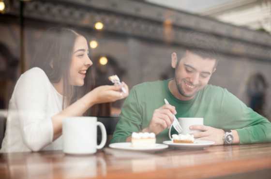 Young couple with coffee and cake - Parkcrest Dental Group.