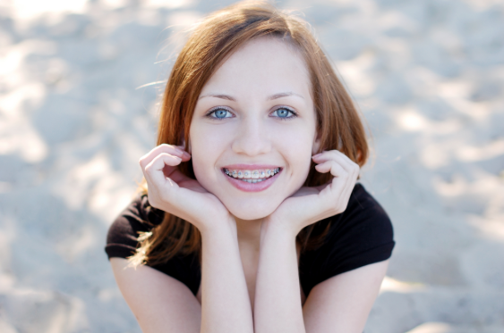 Young girl with braces from Dr. Steven Harrison
