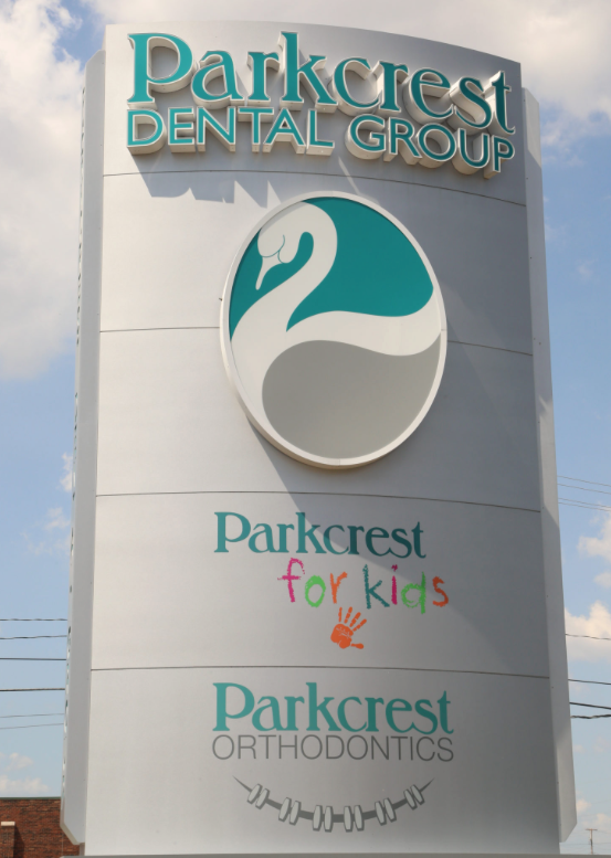Full Parkcrest Dental Group services sign image.