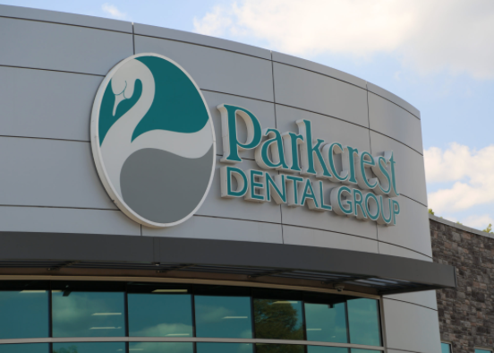 Parkcrest Dental Group sign over entrance.