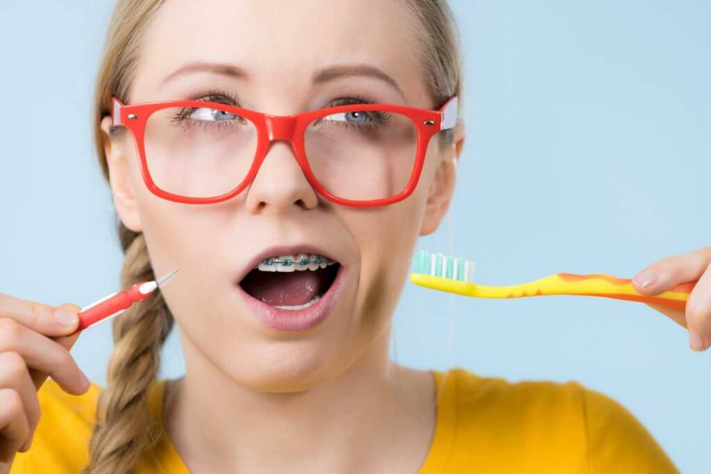 Woman with orthodontic appliances from Dr. Steven Harrison