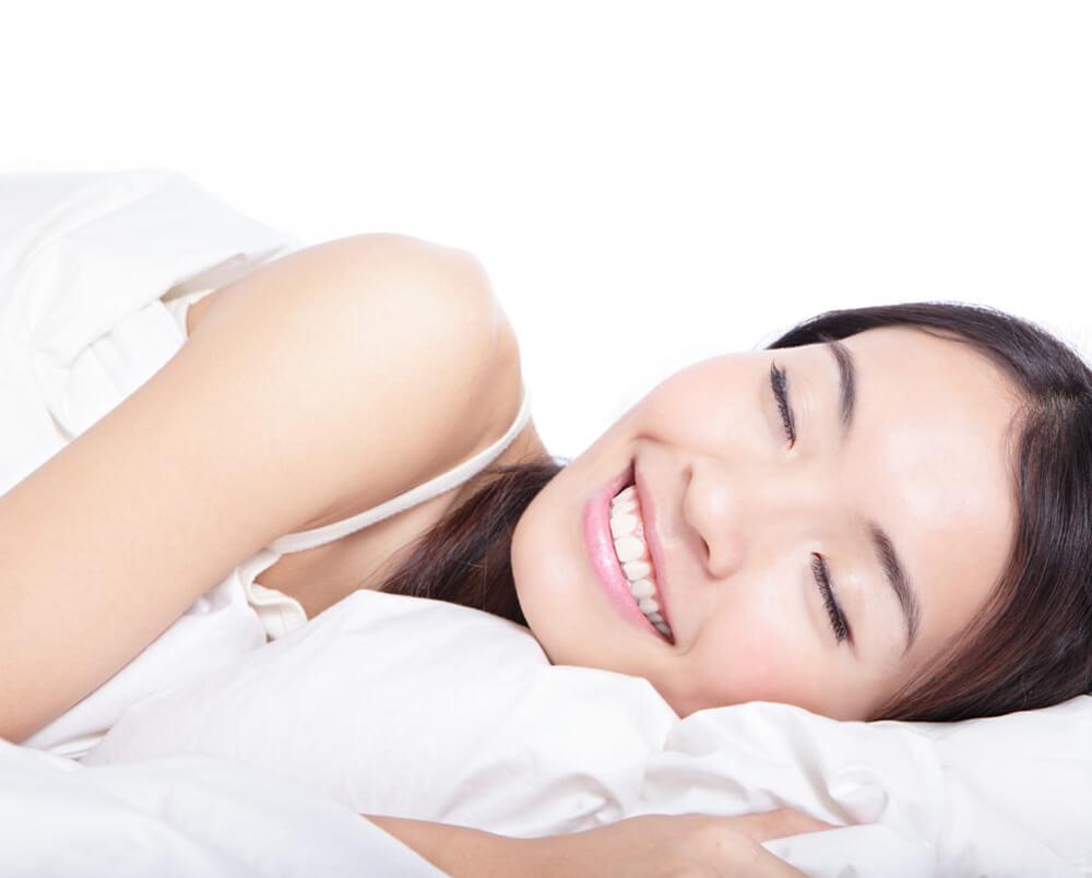 Dr. Harrison - woman with straight teeth sleeping.