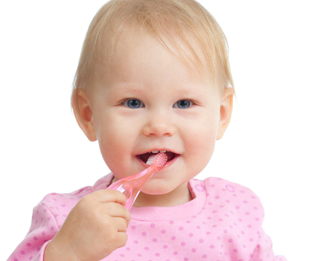 Pediatric dentistry - baby with a toothbrush.