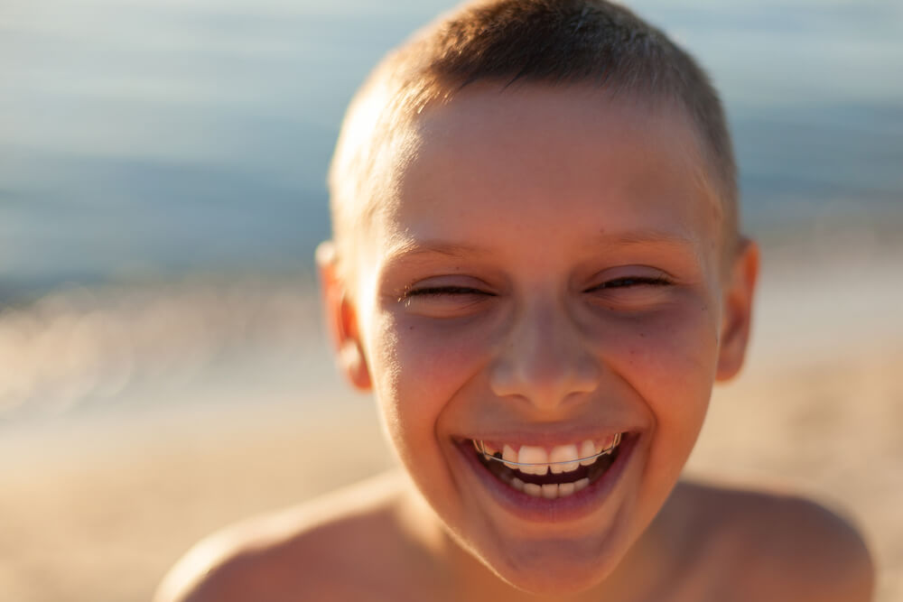 boy on vacation with braces from Dr. Steven Harrison