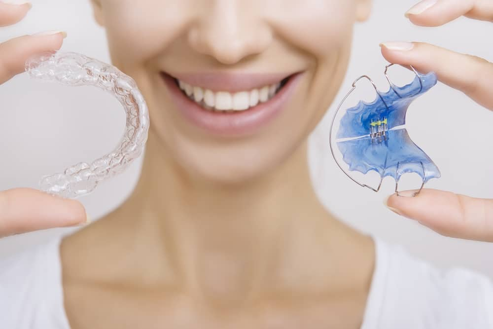 Retainer Smiling Woman Holding Retainer