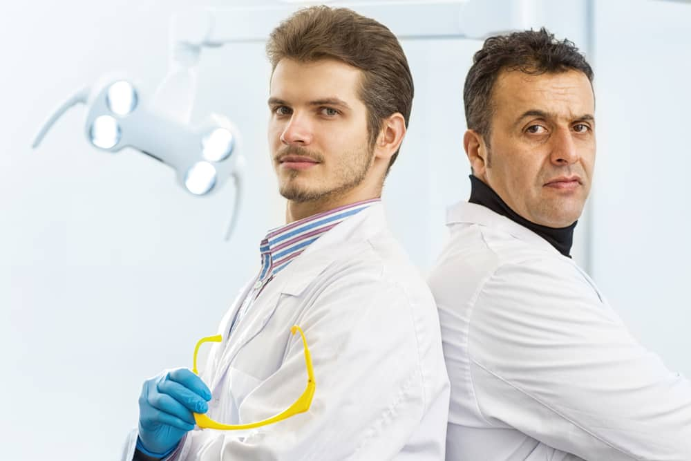 Two dentists back-to-back