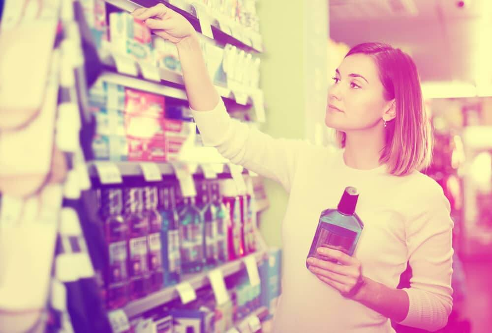 female shopper looking at mouthwash