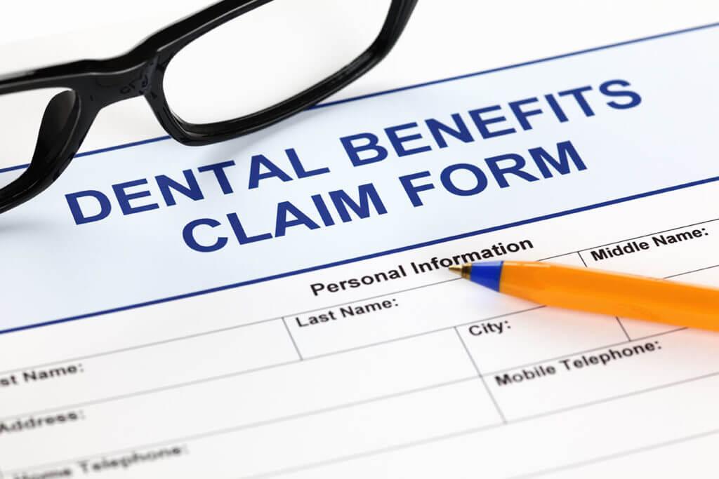 Dental Insurance Paperwork Pen