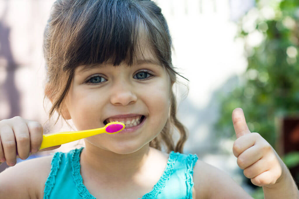 Girl Smile Toothbrush Thumbsup