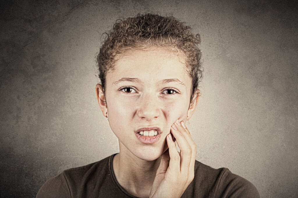 Girl with sensitive teeth