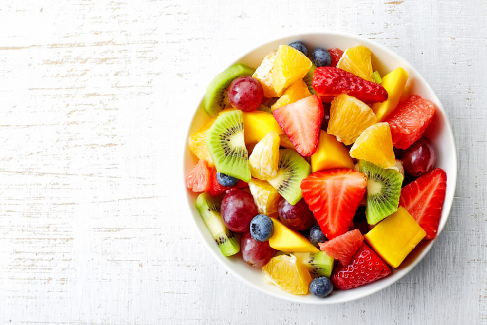 Bowl of fruit against a white background
