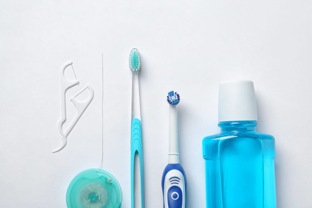 At-home dental tools on a white background.