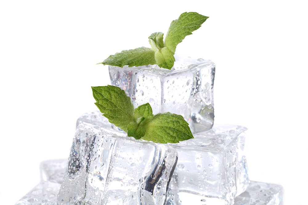 Ice cubes surrounded by mint leaves