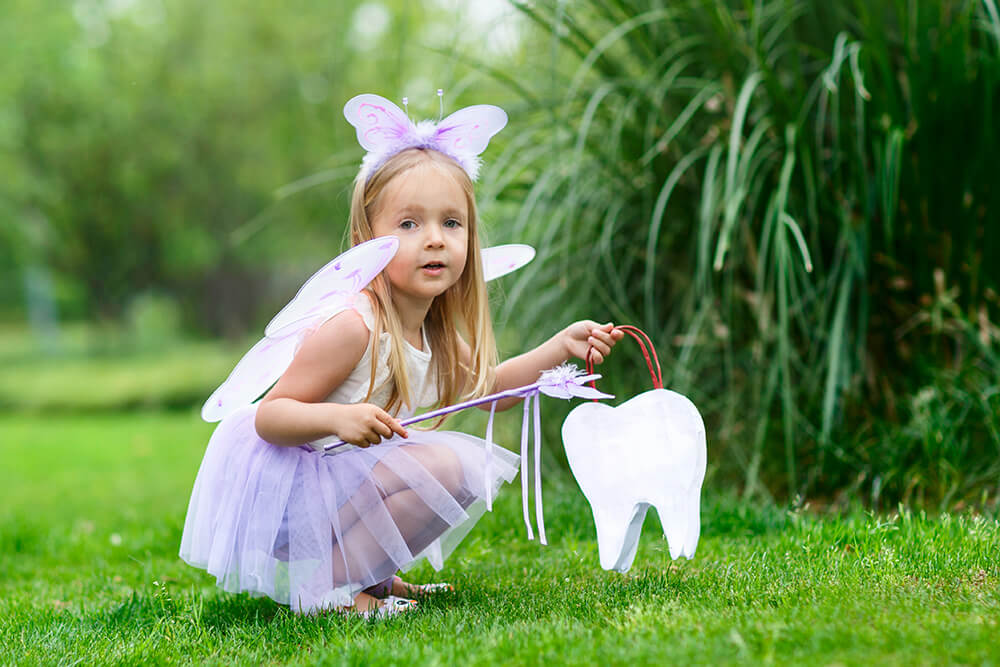 Little girl dressed up as the tooth fairy