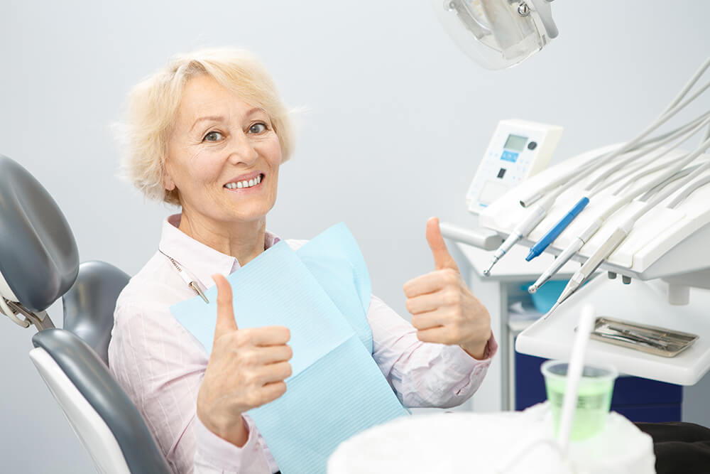Senior woman smiling at the dentist