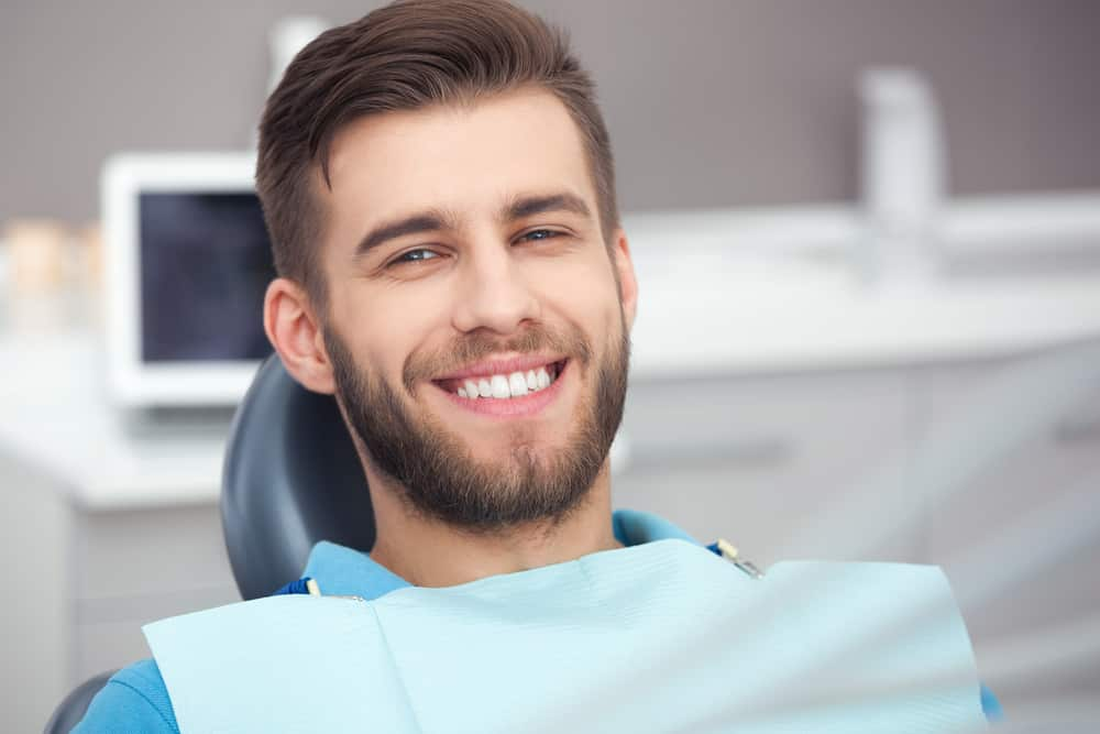 Smiling Man Ready for Wisdom Teeth Removal