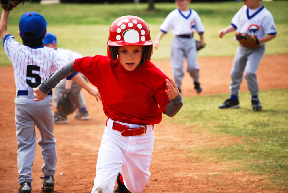 Young child running bases