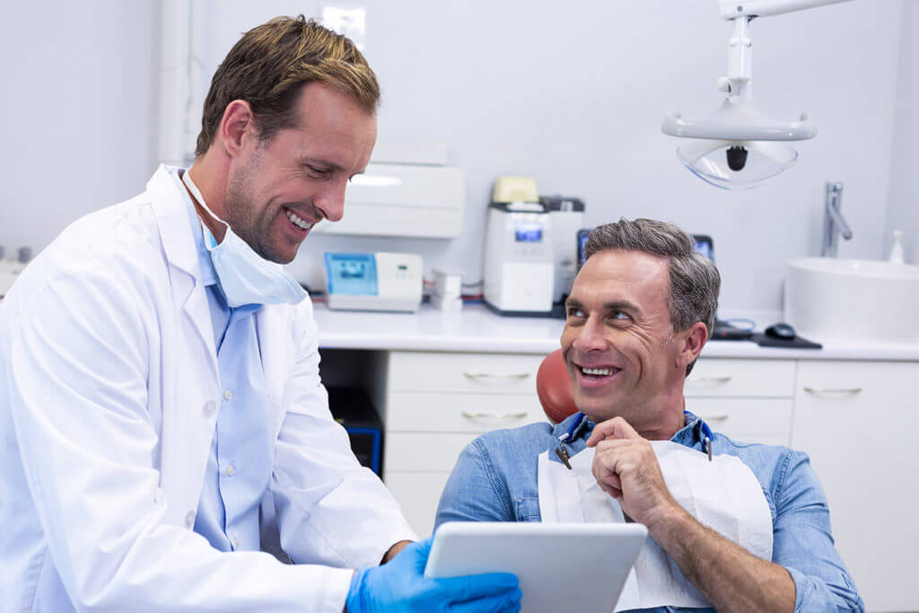 Man speaking to a dentist with Parkcrest Dental Group