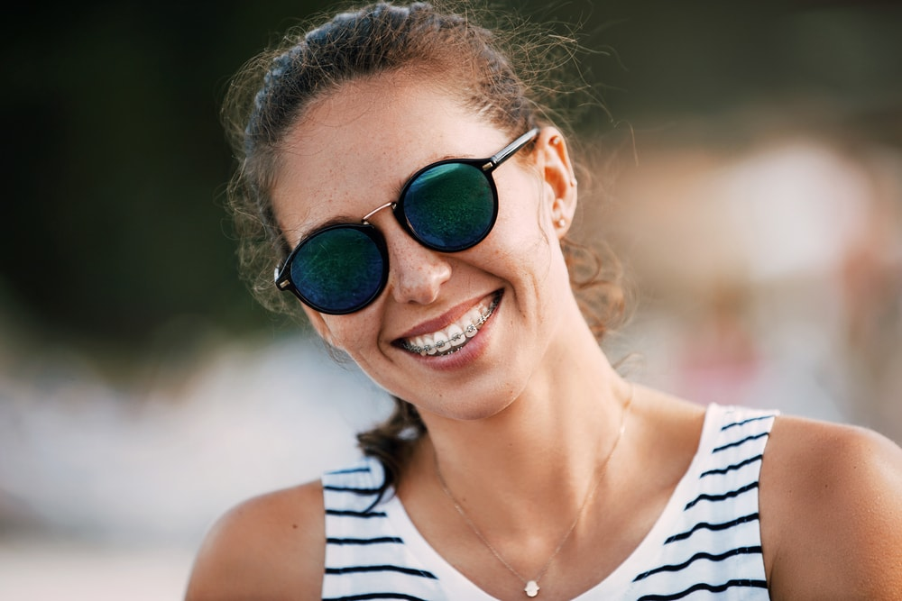 Woman with braces smiling at camera