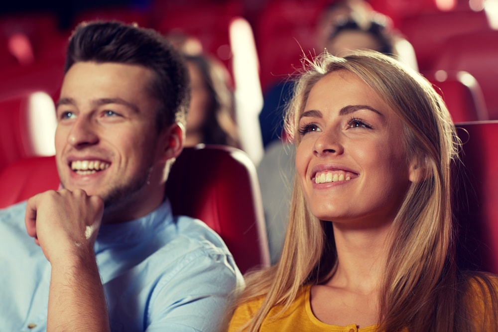 Couple watching movie in a theatre