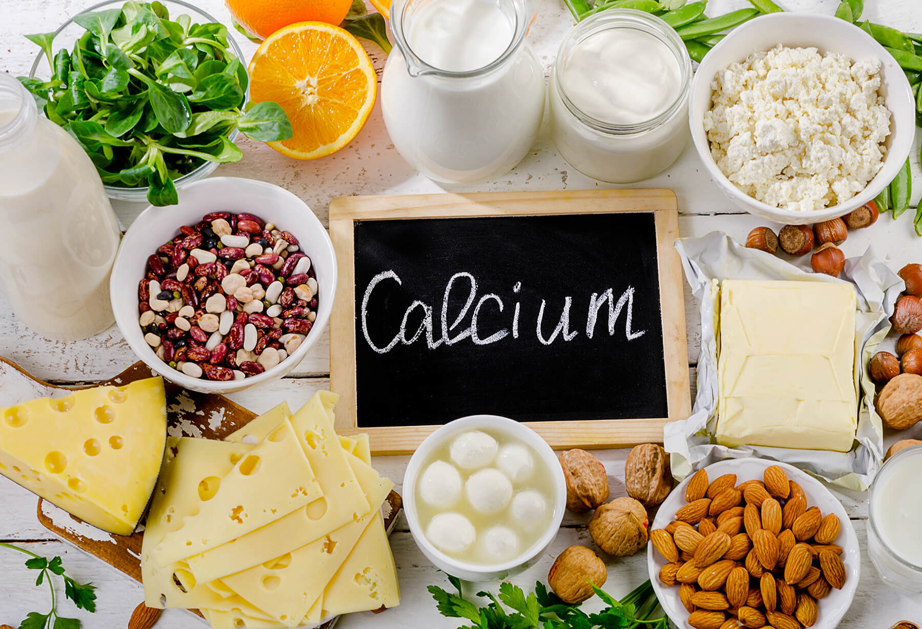 Calcium sign surrounded by calcium-rich foods