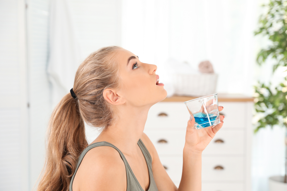 Woman Swishing With Mouthwash